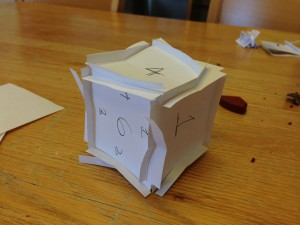 I was able to play around with folding sides of the box and sliding method to form a completely glueless cube. After playing with the cube more, I was able to eliminate the folds and make all walls have some mechanical connection to a adjacent wall.